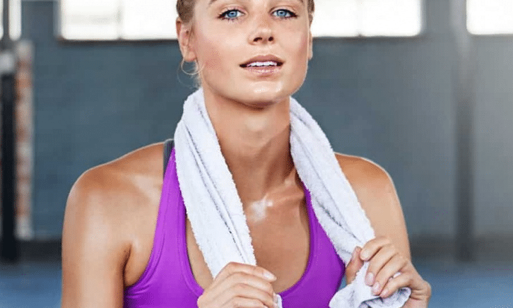 Lady at gym with towel